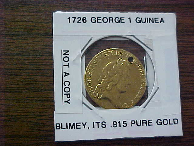 This RARE coin is .915 of PURE GOLD and is a 1726 George 1 Guinea 1 cm coin with a hole at 12 o:clock in the coin. This coin has been polished but in no way has detroyed any of the .915 PURE GOLD. We all know what Gold is selling for now, and this beauty is worth thousands for GOLD, plus the Numismatic value with a coin from 1726.