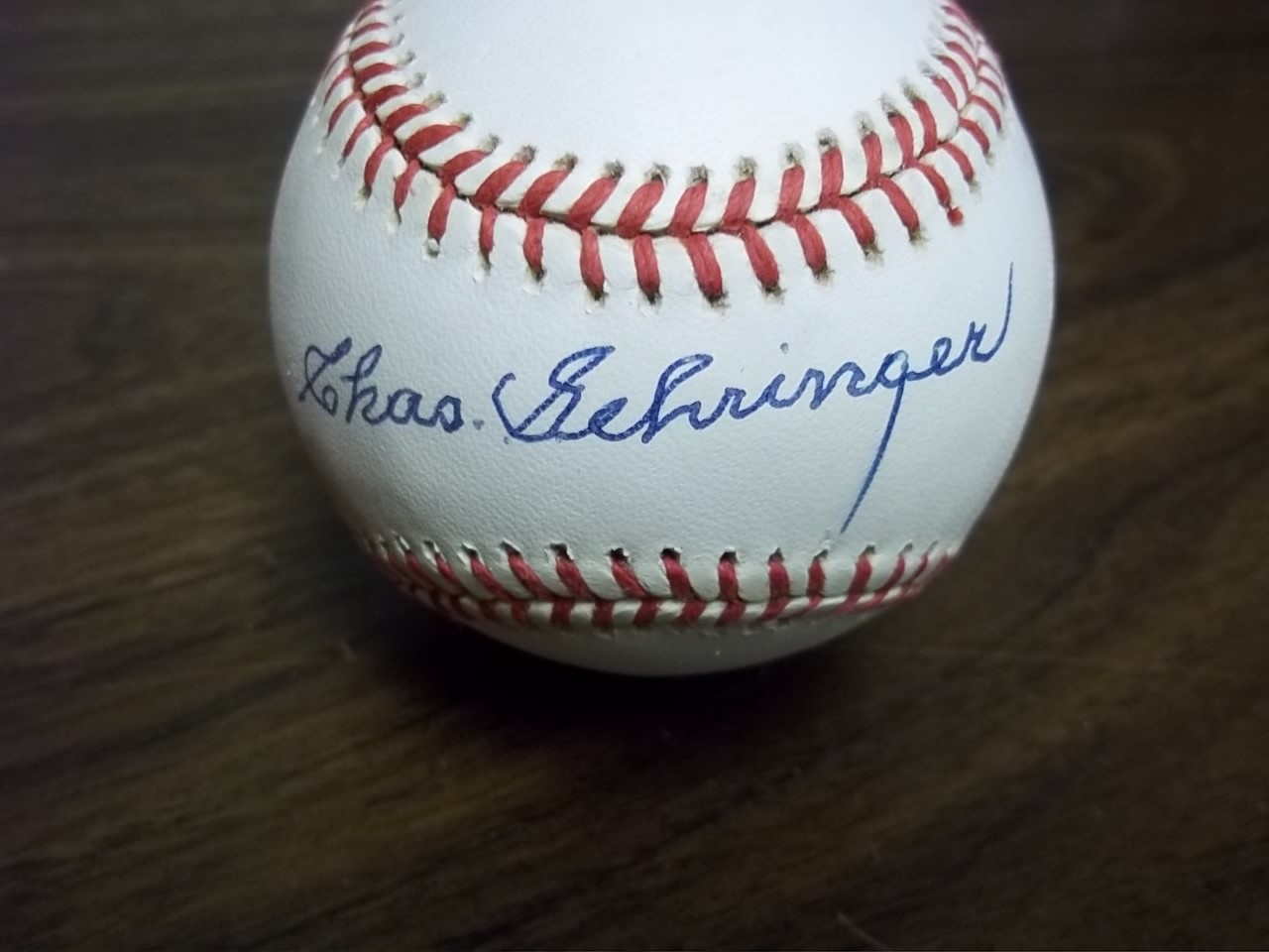This Official AL baseball from Rawlings is cubed in EX condition, and comes blue ink signed across the sweet spot by the '37 AL MVP and HOF Tigers 2nd baseman.  The signature reads Chas. Gehringer, grades a nearly flawless, legible 9, and the ball comes with a full LOA from James Spence for authenticity purposes.  Valued into the mid hundreds!