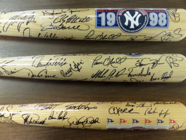 This NY Yankees 1998 Bronx Bombers team logo bat from the reputable Cooperstown Bat Company is in NM/MT condition, and comes barrel-signed all over in black sharpie by 30 members of one of history's greatest teams!  Included are all of the biggies, including Jeter, Rivera, Posada, Pettitte, Torre, O'Neill, Wells, Strawberry, Cone, Williams, Raines, Cashman, and many more.  AWESOME Yanks item, valued well into the thousands!